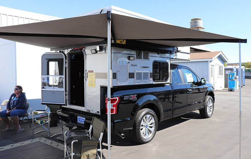 four wheel camper on ford f150 with batwing awning