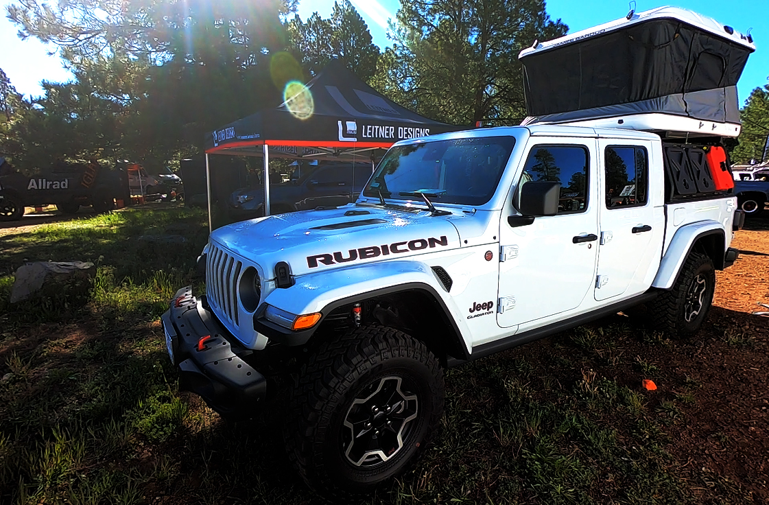overland jeep gladiator rubicon with cargo rack system and roof top tent