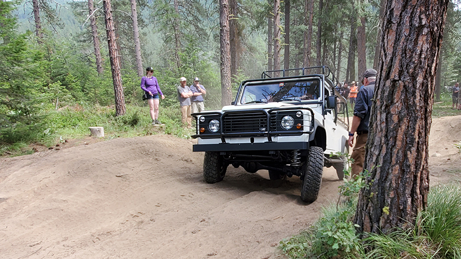 navigating the overland course at northwest overland rally in a land rover defender truck